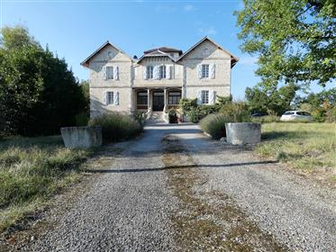 Grand, architect-designed Manor House over 4 floors on 1.8 hectares.