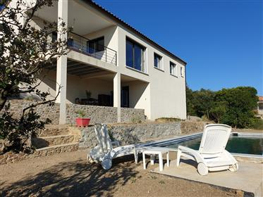 Pleasant village house with 110 m² of living space, garage, sunny garden and views !