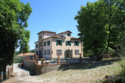 The property consists of an Art Nouveau villa over two levels above ground plus dovecote t