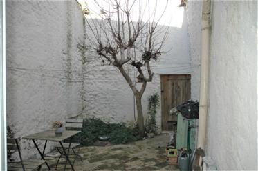 Large village house with 2 courtyards and barn in village close to Narbonne