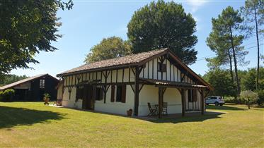 Period property situated on a plot of woodland typical of Les Landes