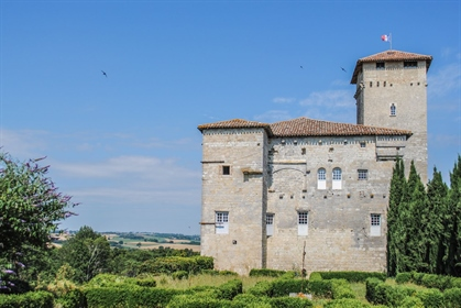 An emblematic, listed, 14th century Gascony castle, with a French formal garden, dominating the Loma