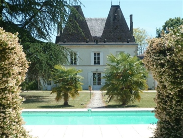 On the banks of the Dordogne, a stone built chateau with 8 en-suite bedrooms surrounded by nearly 3