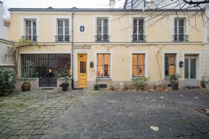 House with mixed status and large paved courtyard