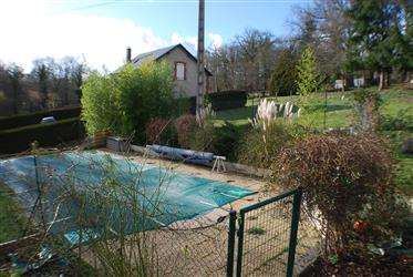 Renovated house, garden, swimming pool.