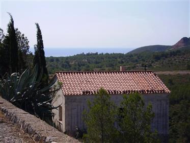 Casa gran vista del mar, las montañas