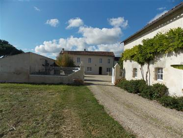 Near Cognac, spacious charentaise house with garden and outbuildings.