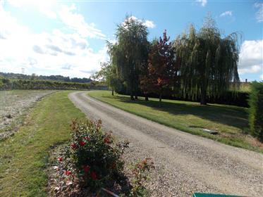 Near Cognac, spacious charentaise house with garden and outbuildings.