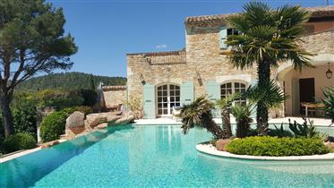 Stone house for sale in Uzès with a nice swimming pool and a landscaped garden