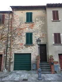 House in medieval square, Lucignano